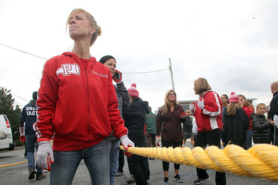 "Members of the Point Pleasant Beach teachers team as they get ready to take on the Manasquan teachers team during The Inaugural Manasquan Inlet Intercoastal Tug that was held across the Manasquan Inlet from Ocean Ave. in Point Pleasant Beach to First Ave. in Manasquan. Six teams of 25 ""tuggers"" competed on Saturday October 20,2018 (MARK R. SULLIVAN/THE COAST STAR)"