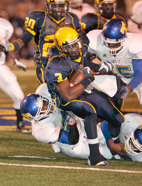 OB RB #3 Daryn Bates is stifled by Tupelo LB Kelsey Stoval and crew
