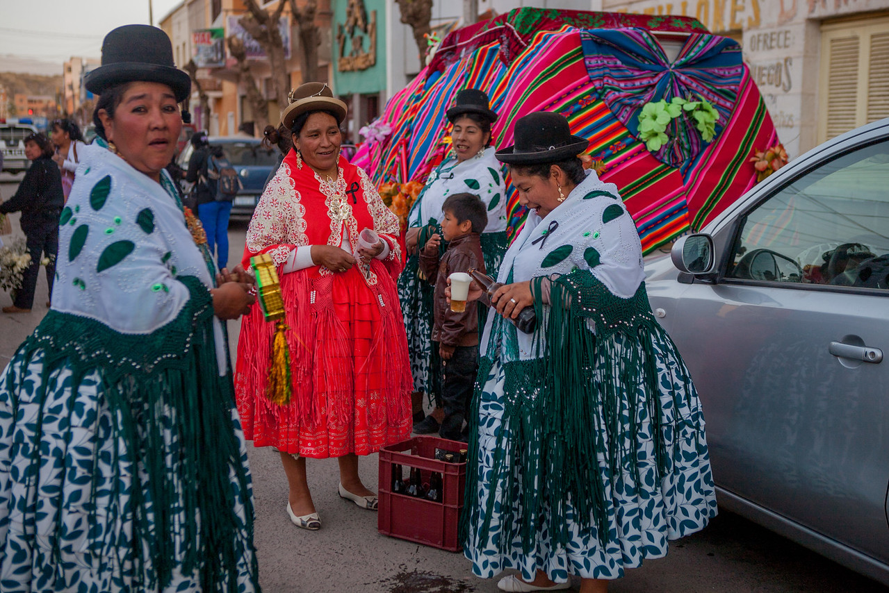 Women enjoying beer during the festival of Virgin of Guadalupe in Tupiza, Bolivia