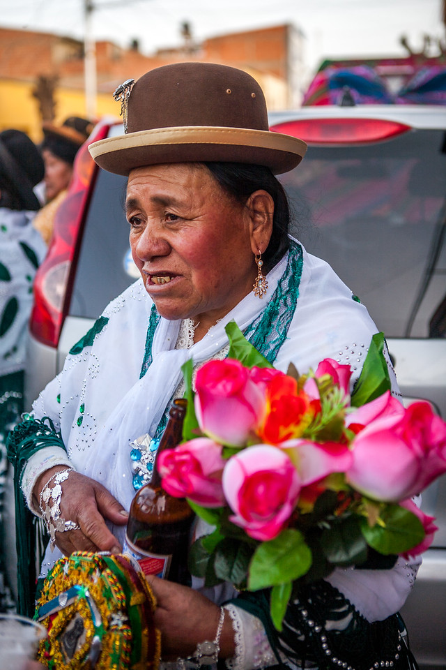 Woman refreshing with beer during the festival of Virgin of Guadalupe in Tupiza, Bolivia