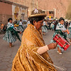 Women dancing in traditional clothes at the Virgin of Guadalupe festival in Tupiza, Bolivia
