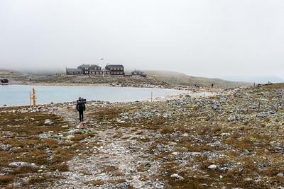 Snøheim dukker opp over siste bakketopp