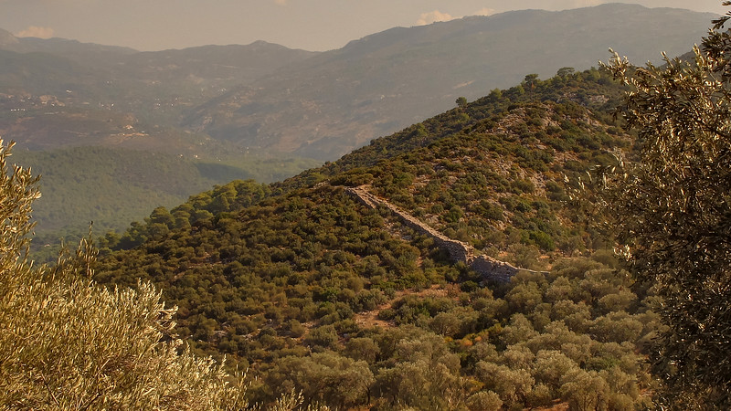 Day 7 - The Aqueduct can clearly be seen crossing the valley.   On the hills on each side the water follows channels cut into the hillside.