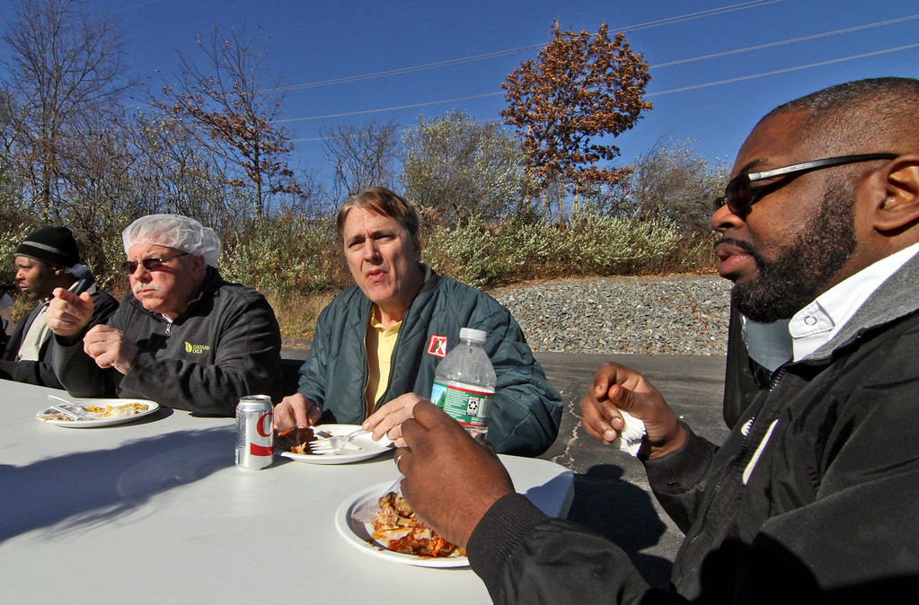 . Catania Oils employee\'s digging into the turkey meal for their annual feast, L-R, Prisco Morella of Arlington, Steve Rogers of Ayer and Reggie Smith of Fitchburg. SUN/David H. Brow