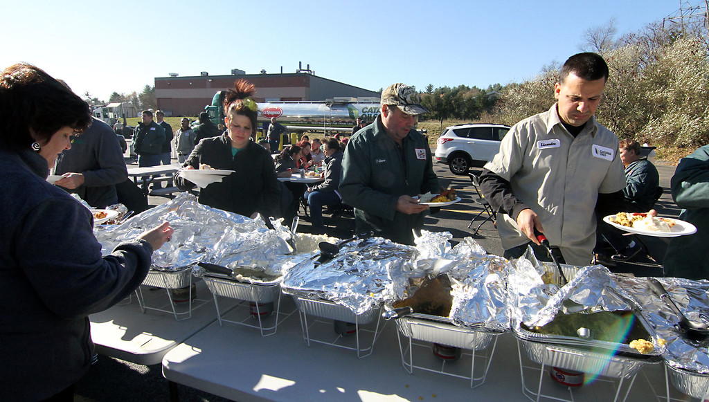 . Employee\'s of the Catania Oils company in Ayer, dig in on the food line for their annual dinner. SUN/David H. Brow
