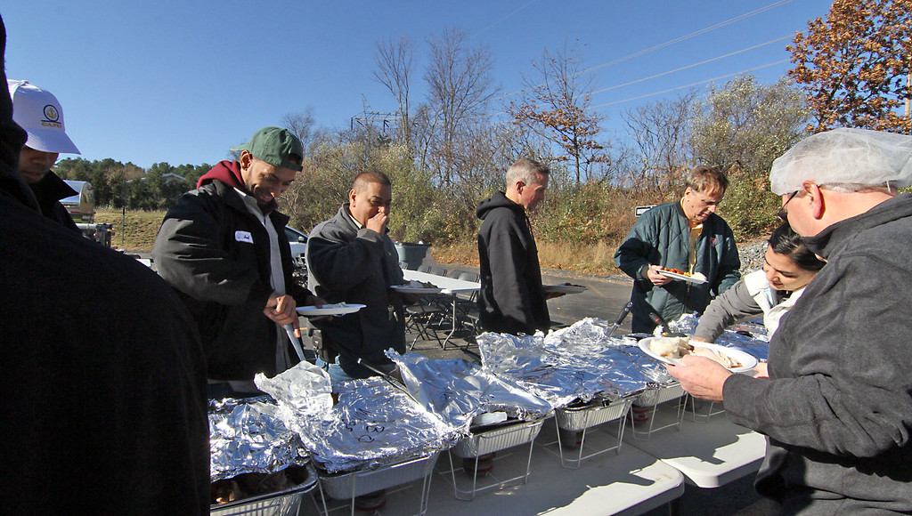 . Start of the food line for the annual Catania Oils employee turkey feast in Ayer. SUN/David H. Brow
