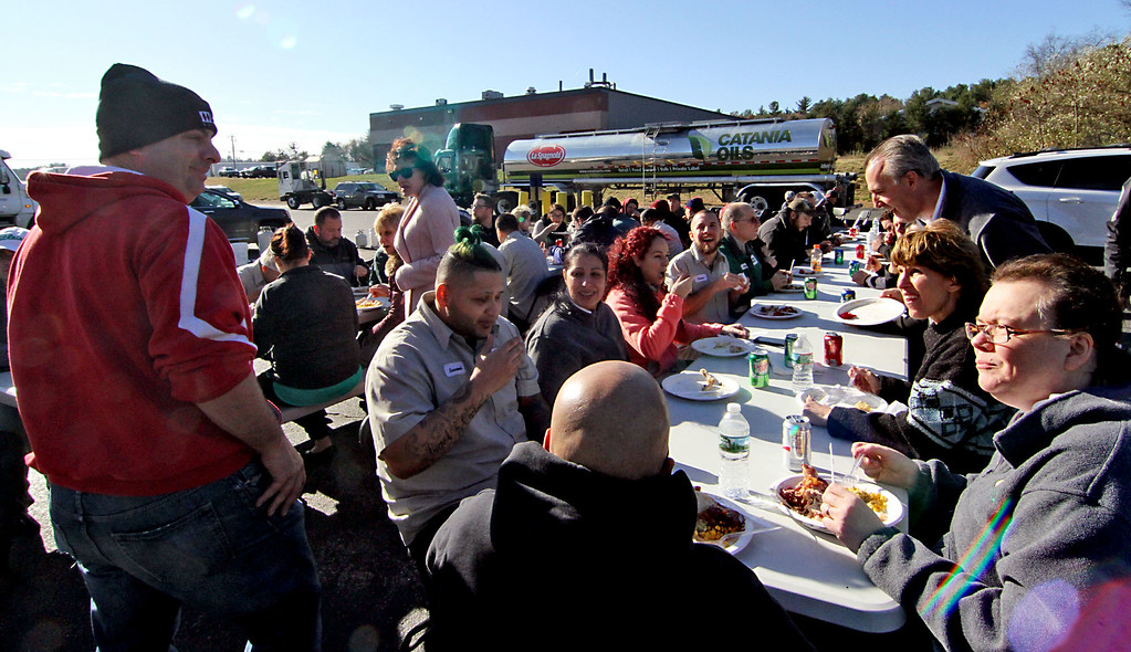 . Catania Oils employees enjoying the deep fried turkey dinner at their annual event in Ayer. SUN/David H. Brow