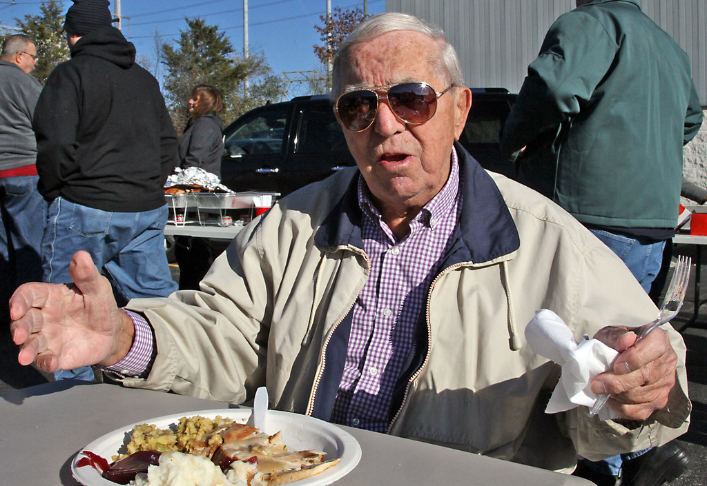 . All set to chow down on his well deserved deep fried turkey dinner is the longest term employee of the Catania Oils Company, Charlie Alvino of Revere,Ma., he retired after 65 years of service when 87, now 90 years old he drove all the way to Ayer from his home in Revere. SUN/David H. Brow
