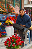 A young man selling flowers at a street market in Afyon, Turkey, Eurasia.
