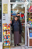 A lady posing for a picture at the front door to her store in Ankara, Turkey, Eurasia.
