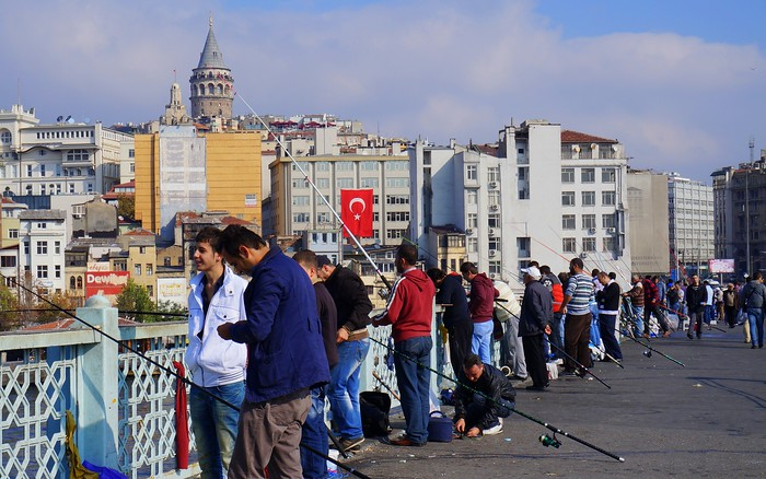 Fishermen on Galata Bridge with Galata Tower in the background.