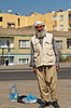 An Arab man in traditional dress waiting for a taxi in Birecik, Turkey, Asia Minor.