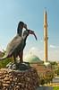 The Bald Ibis monument with a mosque minaret at Birecik, Turkey, Asia Minor.