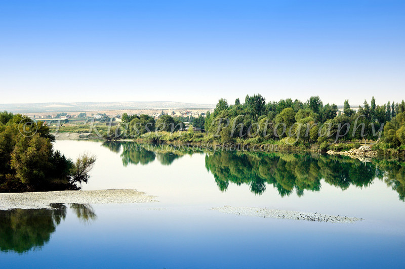 The calm Euphrates River with reflections near the town of Birecik in south central Turkey.