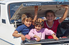 A group of young children playing in the trunk of a car near Birecik, Turkey, Asia Minor.