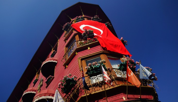 Turkish flag draped on a building.