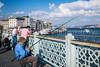 Fishing from the Galata Bridge in Istanbul, Turkey, Eurasia.