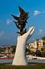 Birds in hand modern sculpture at the port in Kusadasi, Turkey, Eurasia.
