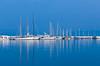 The marina with reflections of pleasure boats at the port in Kusadasi, Turkey, Eurasia.