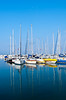 The marina with reflections of pleasure boats in the port in Kusadasi, Turkey, Eurasia.