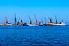 Large cranes loading cargo ships in the port city of Mersin, Turkey, Eurasia.