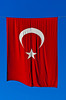 A large Turkish flag hanging over the street in the port city of Mersin, Turkey, Eurasia.
