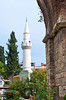 Large pillars with a mosque minaret at the site of the former Christian church at Philadelphia, Turkey, Eurasia.