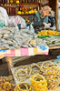 An elderly woman displaying her items for sale at the street market in Sirinci, Turkey, Eurasia.