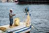 A fisherman mending his net in the Black Sea port city of Sinop, Turkey.