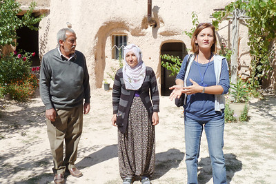 Yasemin with our lunch hosts in front of their tufa home