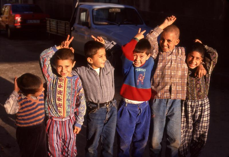 Boys clowning around, Tire, Turkey