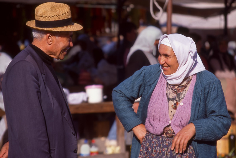 Man and woman flirting in market, Köycegiz, Turkey