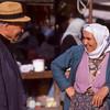 Man and woman flirting in market, Köycegiz, Turkey