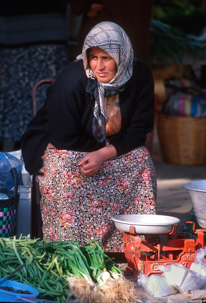 Woman merchant in market, Köycegiz, Turkey