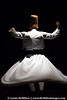 "Sufi Whirling Dervish II:  The ""sema"" or whirling symbolizes an ascent to Devine love."