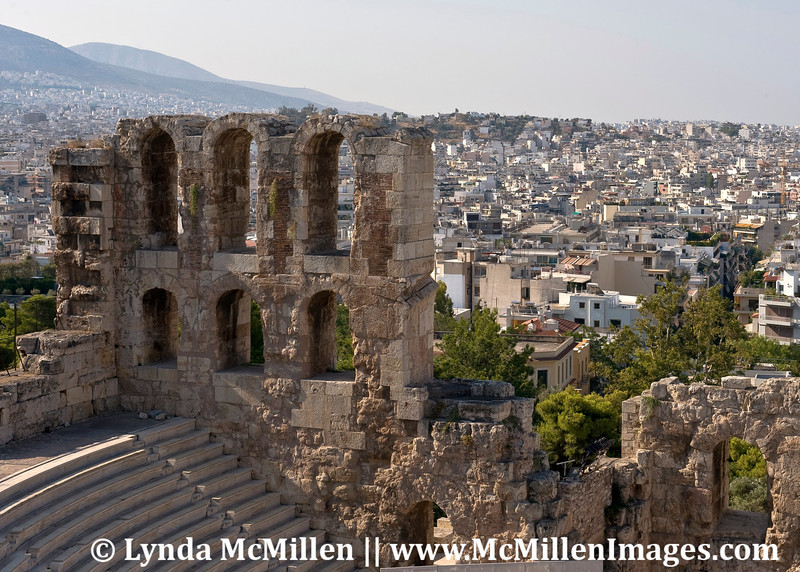 The city of Athens behind the Acropolis theater.