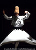 Whirling Dervish of the Mevlevi order, founded by the Sufi mystic Rumi.