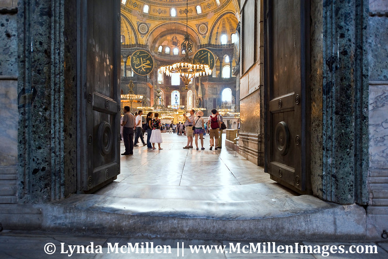 Hagia Sophia's stone entrance shows wear from trillions of footfalls over 1400 years.