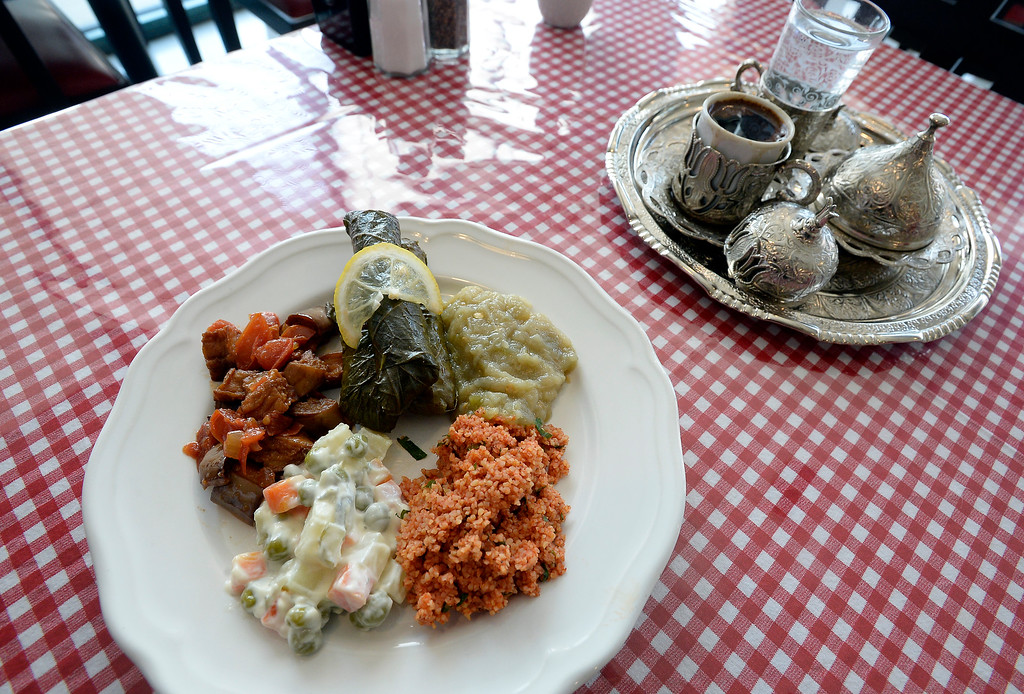 . Boulder, CO - AUGUST 16: Appetizer plate with dolmas, babaganoush, kisir (bulgur) and saksuka (eggplant dish) with Turkish coffee presentation.  (Photo by Cliff Grassmick/Staff Photographer)