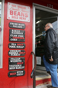Cote's Market, on Salem Street in Lowell, is celebrating a century in business this year and is now in its fourth generation. These signs are next to the door as you walk into the market. SUN/JOHN LOVE
