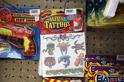 Cote's Market, on Salem Street in Lowell, is celebrating a century in business this year and is now in its fourth generation. They have kids tattoos for sale too. SUN/JOHN LOVE