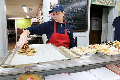 Cote's Market, on Salem Street in Lowell, is celebrating a century in business this year and is now in its fourth generation.Amanda Roy, 29, works behind the deli counter in the market. She started working there about a month ago. SUN/JOHN LOVE