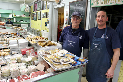 Cote's Market, on Salem Street in Lowell, is celebrating a century in business this year and is now in its fourth generation. Owners Roger Levasseur and his son Kurt in the market on Friday afternoon. SUN/JOHN LOVE