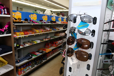 Cote's Market, on Salem Street in Lowell, is celebrating a century in business this year and is now in its fourth generation. You can buy sunglasses in the store if you need some. SUN/JOHN LOVE