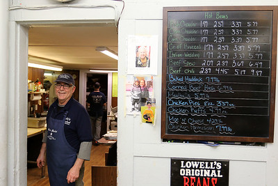 Cote's Market, on Salem Street in Lowell, is celebrating a century in business this year and is now in its fourth generation. Owner Roger Levasseur gets ready to make some sandwiches for the customers. SUN/JOHN LOVE