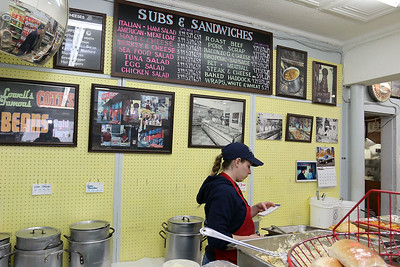 Cote's Market, on Salem Street in Lowell, is celebrating a century in business this year and is now in its fourth generation. Amanda Roy, 29, was hard a work on Friday at the market. SUN/JOHN LOVE