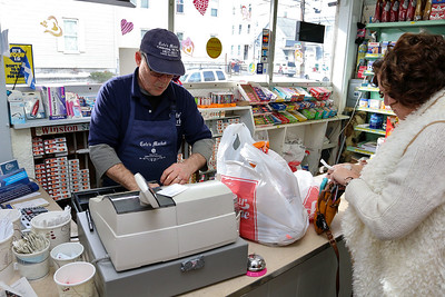 Cote's Market, on Salem Street in Lowell, is celebrating a century in business this year and is now in its fourth generation. Working at the register is owner Roger Levasseur. SUN/JOHN LOVE