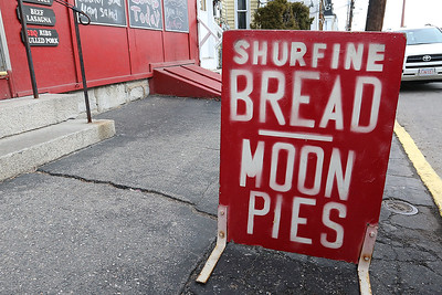 Cote's Market, on Salem Street in Lowell, is celebrating a century in business this year and is now in its fourth generation. One of the signs that they put out on the sidewalk to tell you what they have in store. SUN/JOHN LOVE