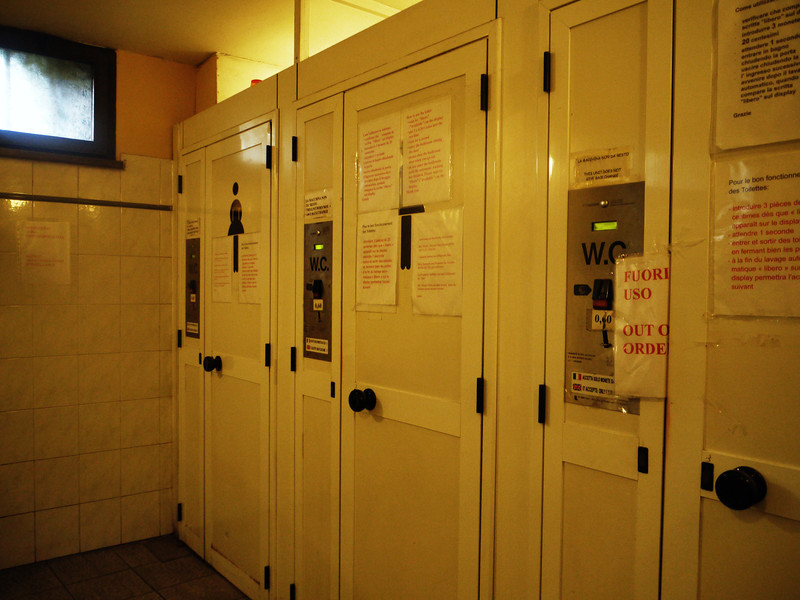 Outside the automatic self-cleaning toilet stalls, complete with multilingual instruction sheets.