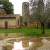 San Gimignano towers reflected in puddles this rainy day